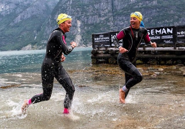 Two happy HUUBsters - Trude and Lotte in Huub wetsuits swim Norseman
