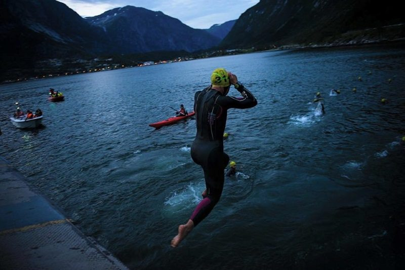 Huub triathlete jumps into the icy Hardangerfjord fjord at the Norseman Xtreme triathlon