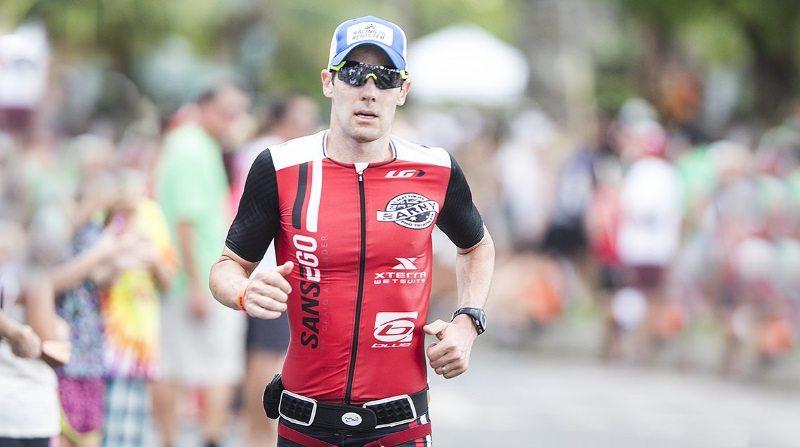 Athlete runs in BOCO Gear hat