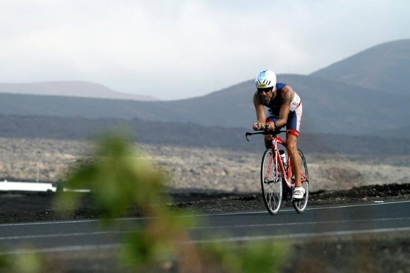 Triathlete on bike - Ocean Lava triathlon