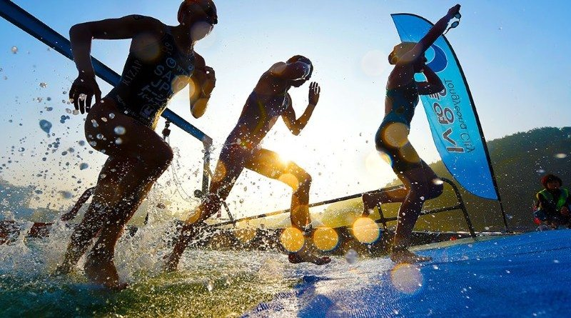 ITU World Cup athletes exit the water - photo credit-Delly-Carr-ITU