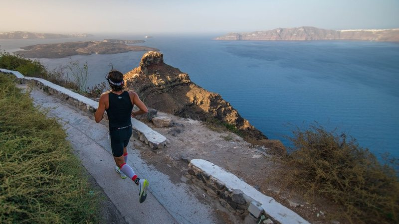 Santorini Experience, athlete running - photo credit Elias Lefas