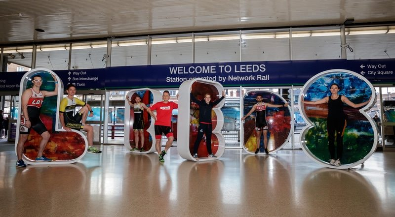 British Triathlete Jess Learmonth (centre) and local triathletes launch entries at Leeds station for the ITU World Triathlon Leeds 2018