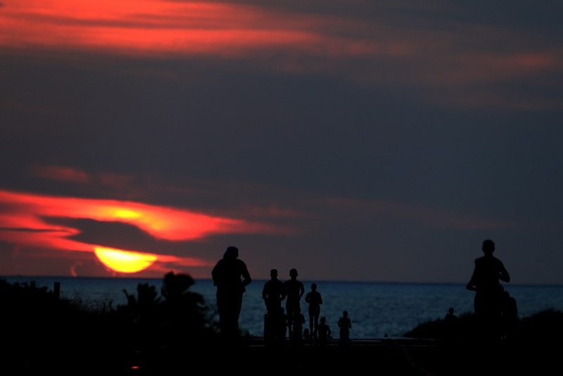 KAILUA KONA, HI - OCTOBER 14: Runners compete as the sun sets during the IRONMAN World Championship on October 14, 2017 in Kailua Kona, Hawaii. (Photo by Tom Pennington/Getty Images for IRONMAN)