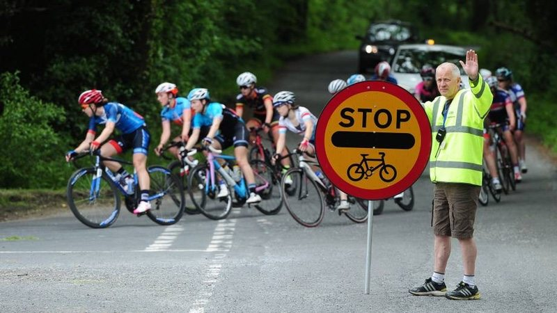 Stop Cycle Race sign - accredited marshalls - photo - British Cycling