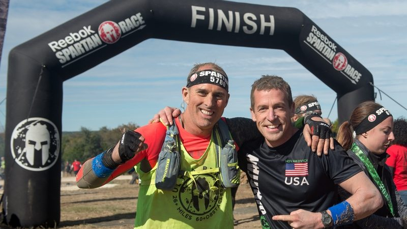 Chris Roussos CEO at 24 Hour Fitness, and Matt Navakovich, Spartan Pro Team Member - photo BusinessWire